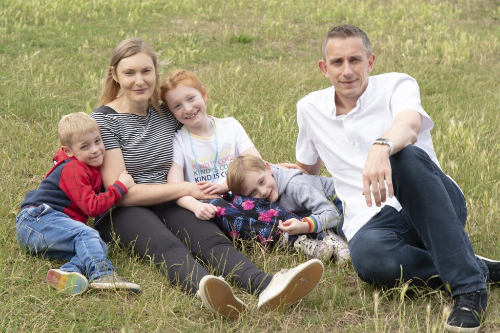 Adèle, 46, with her husband Stuart, 48, and Charlotte, 8, Dylan, 5 and Tyler, 5